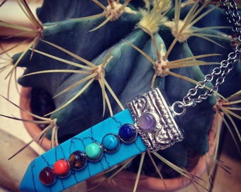 Necklace with turquoise arrow and stones
