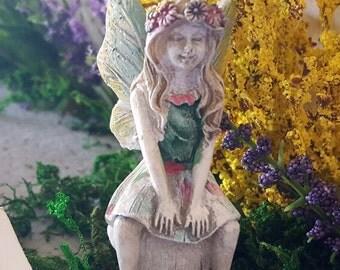 Miniature Fairy Summer on a Mushroom