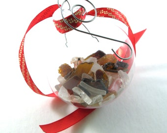 """Rhode Island Mix of Bonfire & Crazed Sea Glass in a 2"""" Round Plastic Ornament with a Red and Gold Ribbon on a Decorative Swirl Hook"""
