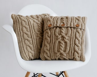 Beige cable knit pillow cover with 3 wooden buttons.