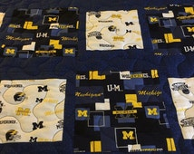 This is a twin  size handmade quilt featuring 2 licensed michigan fabrics.