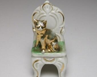 Antique 1900s German porcelain gold cat on a chair figure