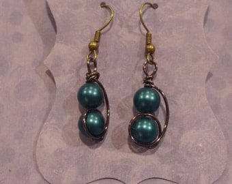 Blue pearled earrings