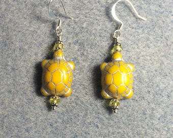 Opaque yellow Czech glass turtle bead earrings adorned with yellow Chinese crystal beads.