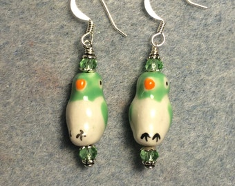 Green and white ceramic bird bead earrings adorned with green Chinese crystal beads.