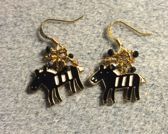 Black and white enamel horse charm dangle earrings adorned with tiny dangling black and amber Chinese crystal beads.