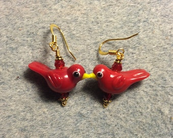 Opaque red lampwork songbird bead earrings adorned with red Chinese crystal beads.