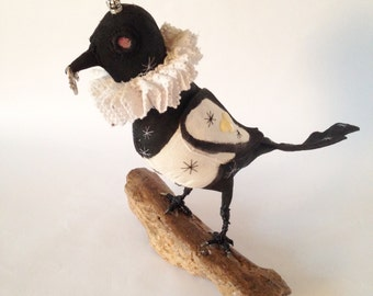 Hand made magpie with Elizabethan collar.