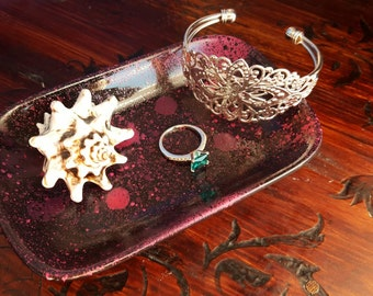 Pink, purple, and black jewelry dish
