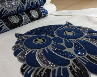 "Limited Edition ""OWL"": Body in white cotton with sparkles and mat velvet flocking."