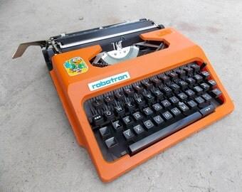 Working typewriter Cella Robotron with plastic case, vintage manual typewriter, Orange typewriter, Home decor, office decor, gift idea