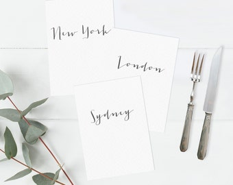 Wedding table name cards. Postcard size table cards. Table plan.