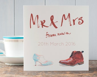 A personalised Wedding congratulations card for the happy couple with the date of their wedding on the front, Mr and Mrs, wedding shoes card