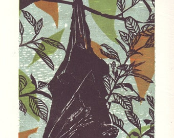 original linocut of a fruit bat