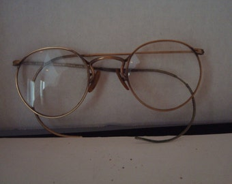 Vintage gold rimmed eyeglasses with case