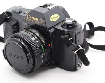 Canon T50 SLR 35mm Film Camera with 50mm lens and flash - Tested and working 1980s classic
