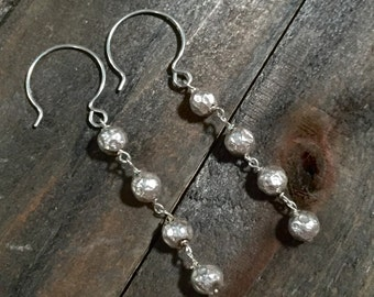 Sterling silver hammered earrings.