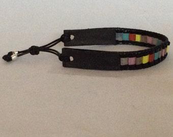 narrow bracelet with miyuki tila beads trimmed with genuine leather.