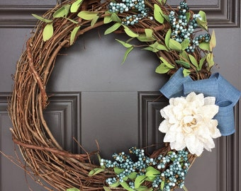 All Season grapevine wreath with ivory burlap flower, blue accents, and greenery; monogram wreath