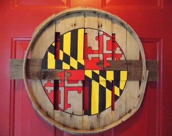 Maryland flag center circle w/ exposed natural wood Greek Cross. Hand painted on recycled crab bushel lid.