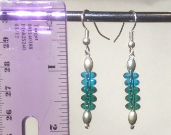Earrings with silver tone posts and wire eyepin with silver and blue glass beads