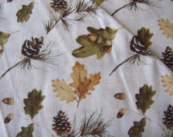 Windham 41565-3 Northwoods, white and tan background with variety of leaves and acorns