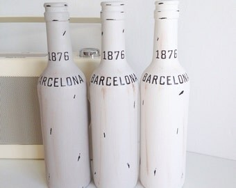 Hand painted and distressed set of three glass bottles