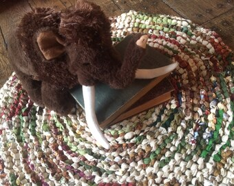 Tan, green, and red rag rug