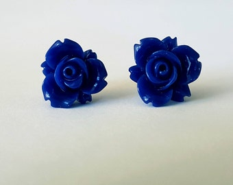 Blue resin flower stud earrings.