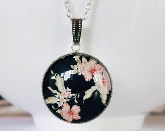 Black floral glass cabochon silver pendant necklace.