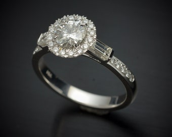 Engagement ring in 14kt white gold with Micro pave Halo and side baguettes round diamond Center stone