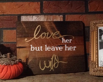 Love Her But Leave Her Wild wood sign
