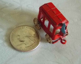 """Tiny Red Metal Carriage Stagecoach With Driver Driver 1"""" Wheels Rolls Vintage Miniature"""