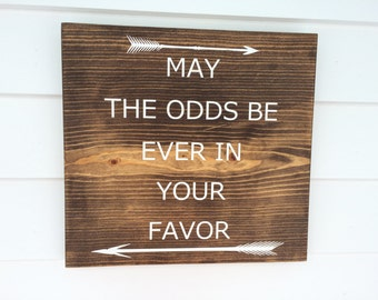 May the odds be ever in your favor.  Wood sign, quote from the Hunger Games Movie