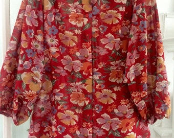 Lightly sheer red floral bouse