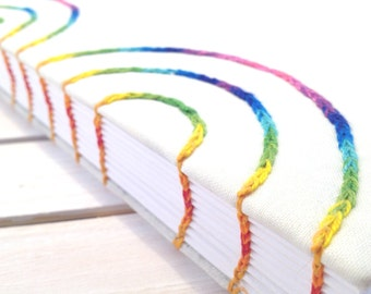 Handmade notebook with spiral embroidery in rainbow shades. Perfect as a bullet journal, wedding planner, or recipe book.