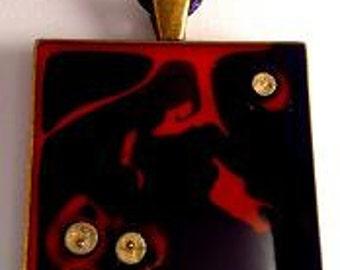 Bronze resin pendant.