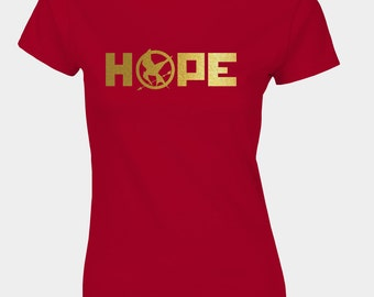 Ladies Hunger Games inspired Mockingjay district 12 t-shirt with gold emblem and text HOPE.