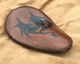 Hand tooled leather motorcycle bobber seat with Dragon Wyvern design