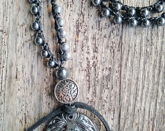 Crochet hematite bead necklace with hematite lion locket and flat silver bead