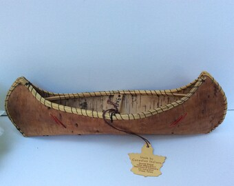 Mid century Birch Bark canoe. 10 inches long. Handmade by Canadian Indians as a souvenir for travelers to Ottawa.