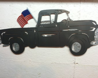 Old truck with hand painted flag