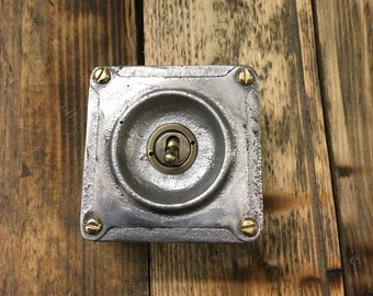 Vintage stye toggle light switch in industrial cast metal
