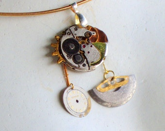 Steampunk pendant necklace featuring vintage watch parts and copper sheet accent