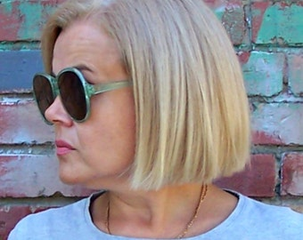 Vintage Soviet Sunglasses. Retro Round Sunglasses with Plastic Frame and Glass Lenses. Accessory from the Soviet Era.