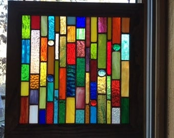Hanging stained glass sun catcher in custom wooden frame