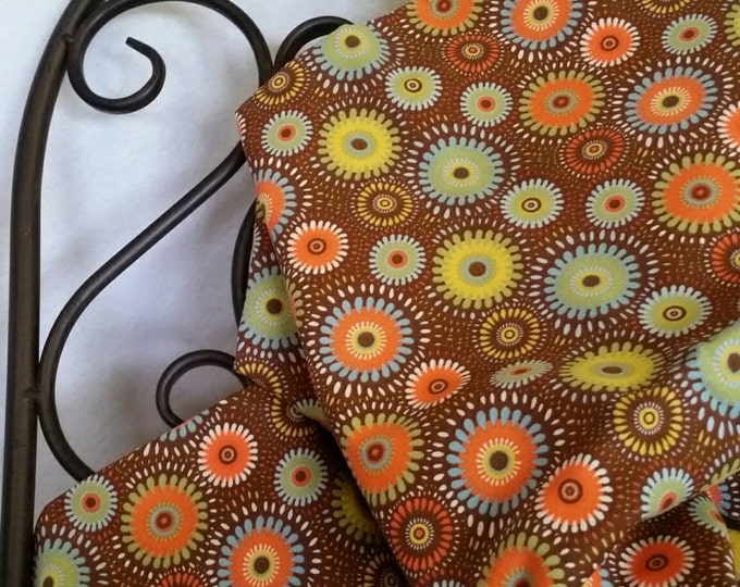 Geometric flowers on a Field of Brown Quilting Fabric