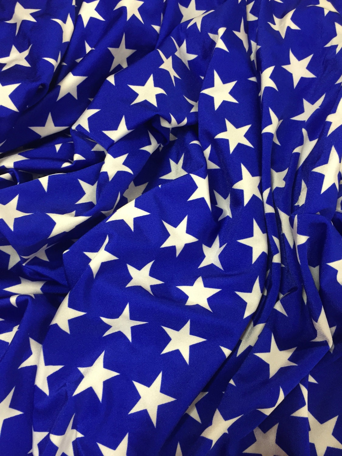 Bright royal blue with large white stars spandex fabric by for Star fabric australia