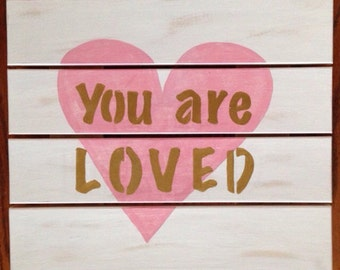 Wooden You Are Loved sign in white, lime green and grey.