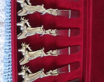 Vintage box of Santa's reindeer butter knives / Vintage Santa's reindeer butter knives box